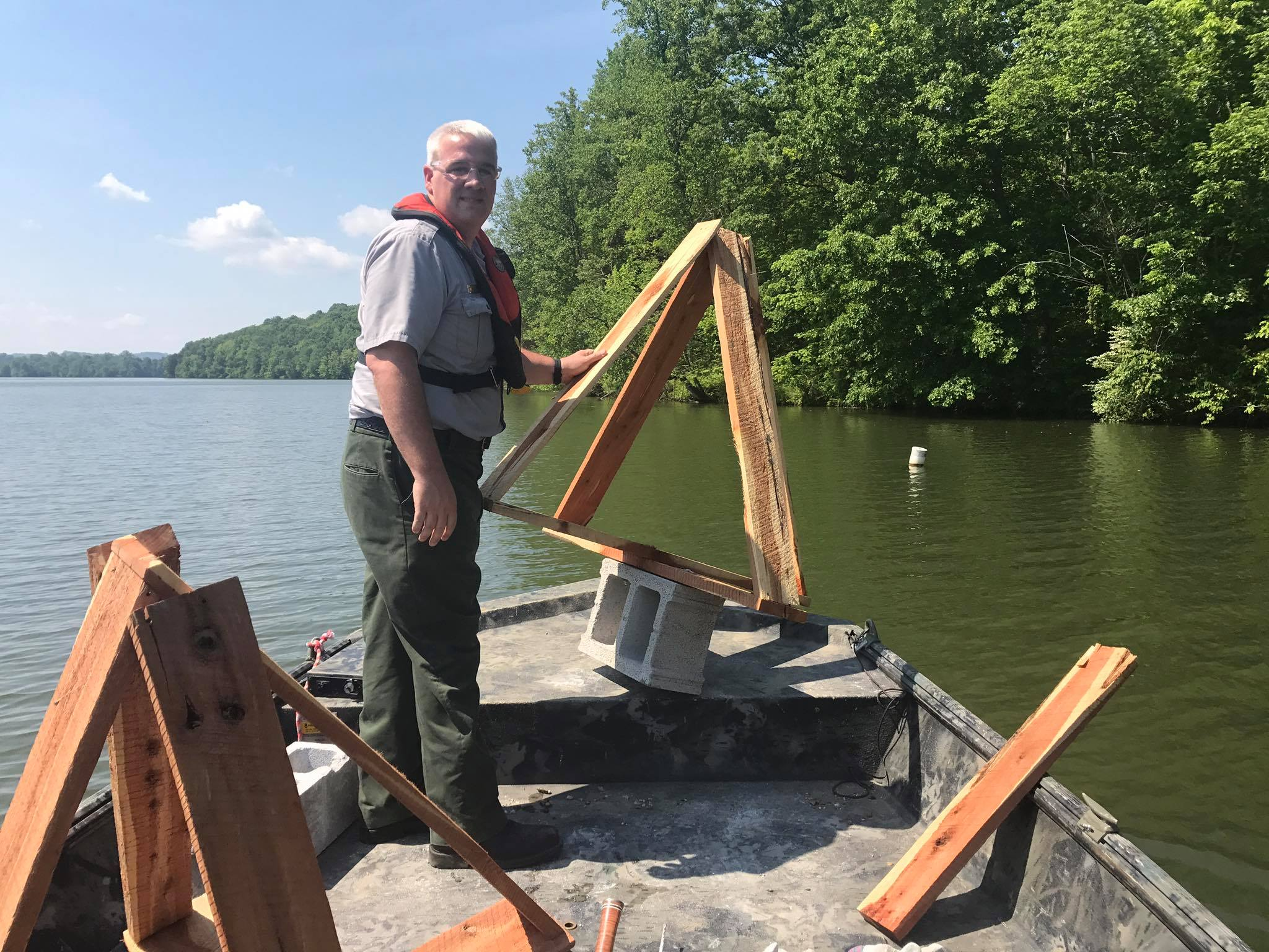Conservation Biologist, Kenny Claywell, set wooden tepee fish attractors in Buffalo Creek Cordell Hull Lake.