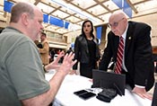 Ron Douglas (sitting), U.S. Army Corps of Engineers Nashville District Information Technology chief, provides information to Scott Allen, chief executive officer of Wisdom Tree Technologies, and Valerie Daquilla, executive assistant, during the First Annual Nashville District Small Business Opportunities Open House at Tennessee State University in Nashville, Tenn., March 16, 2017. (USACE photo by Leon Roberts)