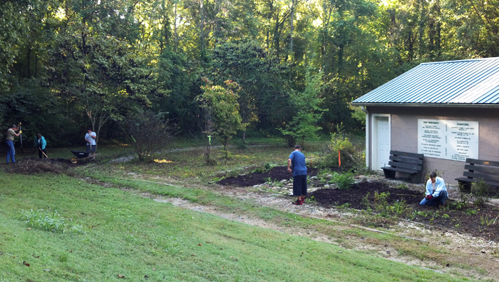 Volunteers work on a landscaping project at Cheatham Lake