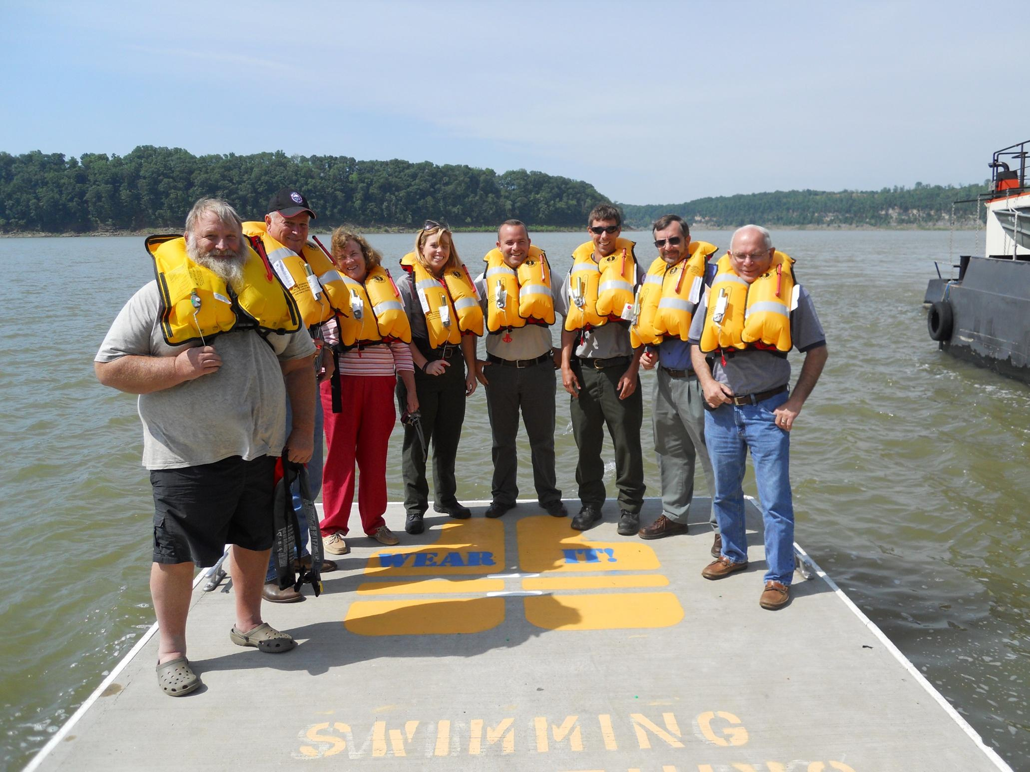Rangers and Visitors show off inflatable life jackets during the Ready, Set, Inflate Event at Lake Cumberland