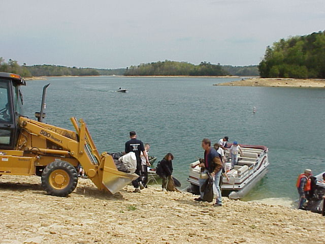 Volunteers clean up the shoreline during a shorline cleanup
