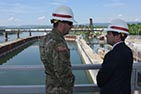 Lt. Col. Stephen Murphy, U.S. Army Corps of Engineers Nashville District commander, briefs Congressman Chuck Fleischmann, Tennessee District 3, while overlooking the coffer dam where construction of a new lock has resumed during a visit to the project in Chattanooga, Tenn., April 25, 2016.