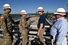 Lt. Gen. Todd T. Semonite (Second from Left), U.S. Army Corps of Engineers commander, receives a briefing at the Chickamauga Lock Replacement Project in Chattanooga, Tenn.
