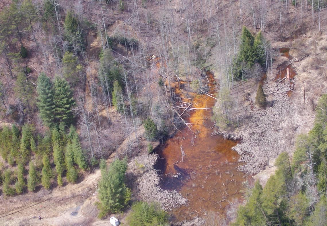 A before picture at Ely and Puckett Creek in southwestern Virginia were the Corps of Engineers restored the ecosystem damaged by acid mine drainage resulting from abandoned coal mines.