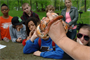 Park Ranger Amy Redmond shows a corn snake to a group of 6th graders from Hawkins Middle School during a presentation about snakes in Tennessee.  There were 11 learning stations that kids rotated between on Environmental Awareness Day at Old Hickory Lake.  The U.S. Army Corps of Engineers Nashville District sponsors events like this to draw awareness to subjects in science, technology, engineering and mathematics.