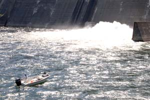 A fishing boat gets close to hazardous waters at Center Hill Dam