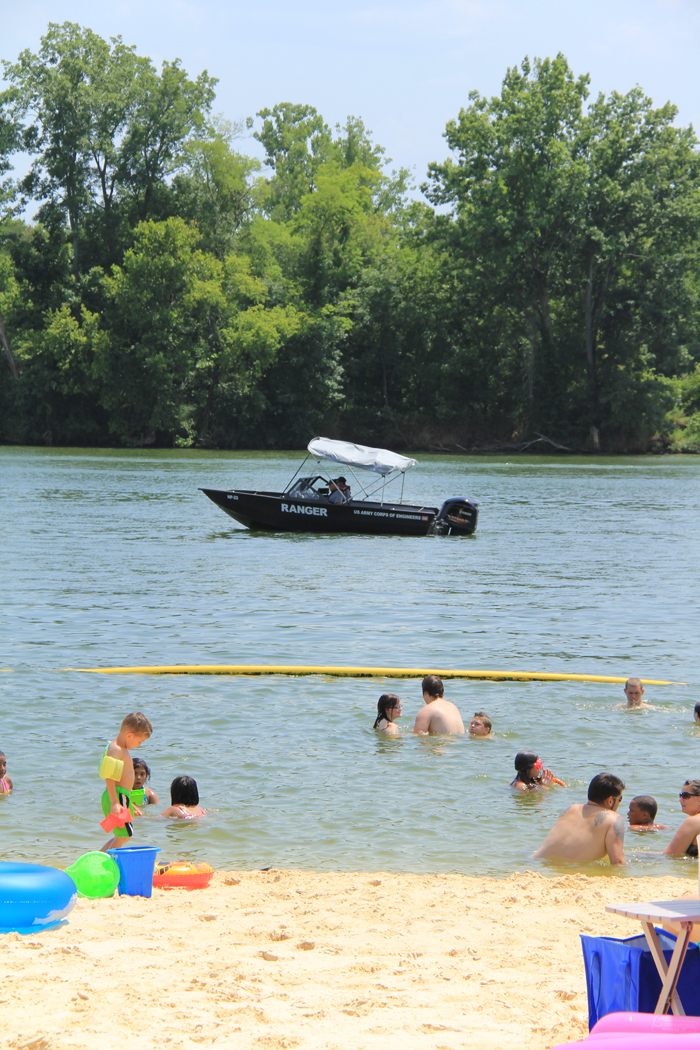 Cheatham Lake patrol boat going by one of the recreation areas  at Cheatham Lake