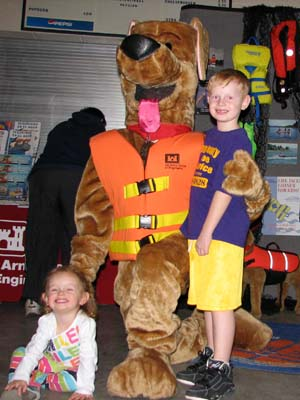 Children posing with Bober the Water Safety Dog