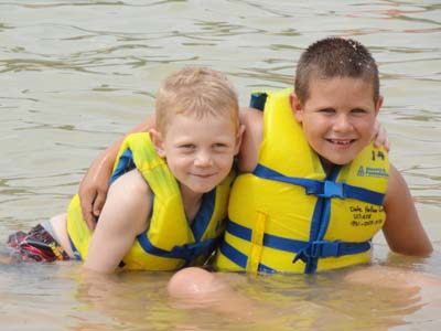 Two boys wear their life jackets at Dale Hollow Lake
