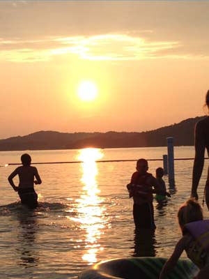 People swim during a gorgeous sunset at Dale Hollow Lake