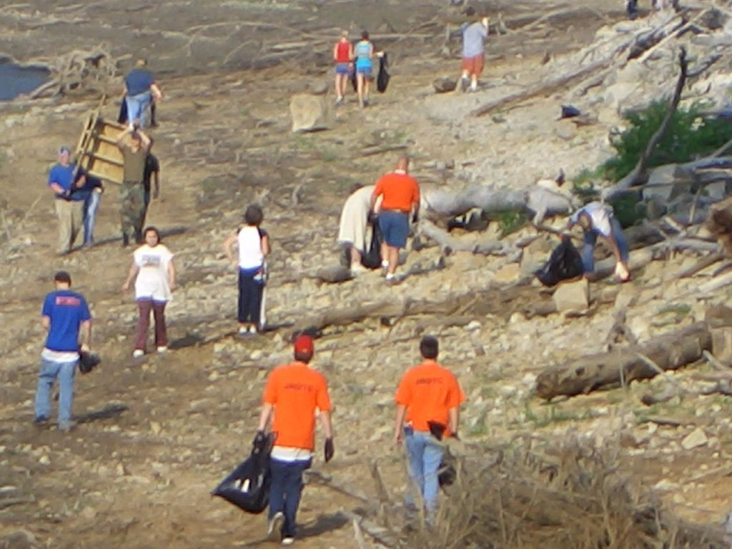 Volunteers picking up trash along the shoreline during Lake Cumberland's Shoreline Cleanup