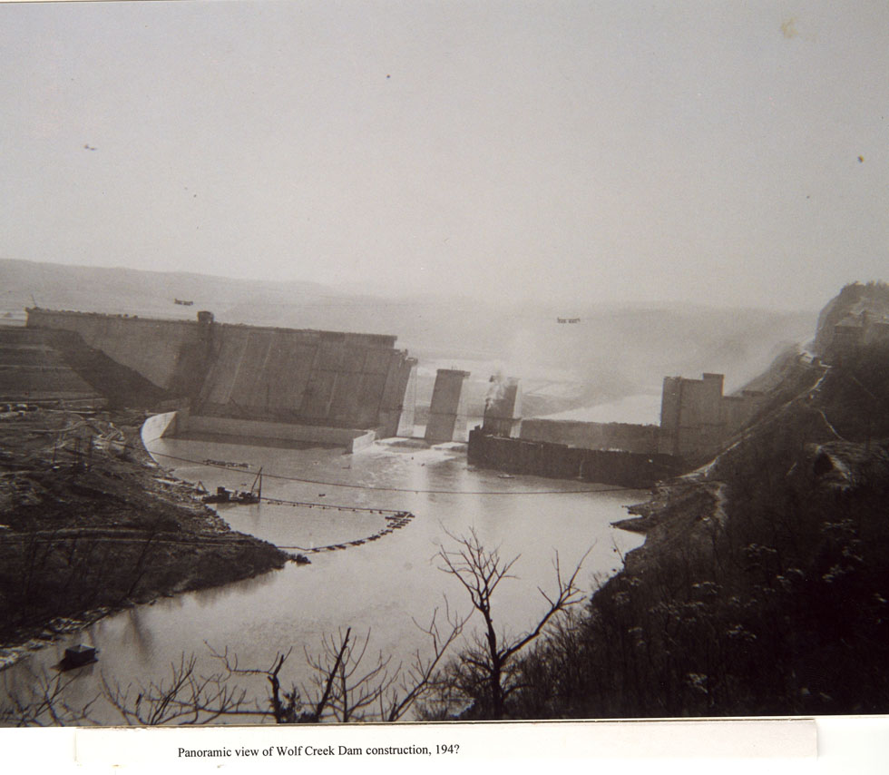 Overview photograph of the construction of Wolf Creek Dam at Lake Cumberland