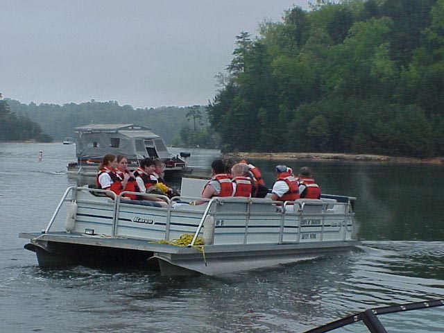 Boaters wearing life jackets on Laurel River Lake, Harlan, Ky.