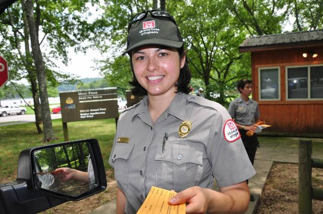 Park Rangers distribute day use tags at Cedar Creek Day Use Recreation Area.