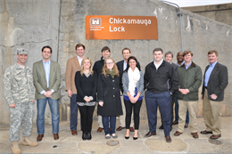 Congressional staff members stand below a Chickamauga Lock sign during their April 3, 2013 visit to the deteriorating, 73-year-old, TVA-owned and Corps-operated and maintained Chattanooga facility.