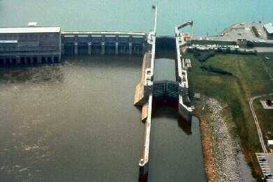In this aerial photo, notice that the lock is partially filled. By lowering the water level, lake pressure is kept on the doors.
